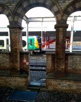 The built environment: a 350 heading for Liverpool Lime Street calls at Crewe's platform 12 in January 2015. The chequered sign to the left of the gap in the wall reads 'Limited Clearance'.<br><br>[Ken Strachan&nbsp;28/01/2015]