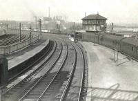 View north over Rutherglen station on 10 March 1956. On the right a train for Balloch is preparing to leave behind Caley 0-6-0 57631.<br><br>[G H Robin collection by courtesy of the Mitchell Library, Glasgow&nbsp;10/03/1956]