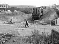08793 awaiting the gates at Seafield level crossing on 25 July 1989 on its way from Millerhill depot to Leith South yard. [See image 50214]<br><br>[Bill Roberton&nbsp;25/07/1989]