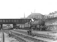 An eastbound freight passes through Bellgrove station behind a Black 5  in September 1958.<br><br>[G H Robin collection by courtesy of the Mitchell Library, Glasgow&nbsp;16/09/1958]
