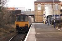 In preparation for electrification to Blackpool North, various overbridges along the route are being raised. These include the bridge at Kirkham, seen here on 2 February 2015 as a Northern service to Blackpool North arrives at the platform.<br><br>[John McIntyre&nbsp;02/02/2015]