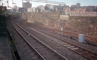 An overview of Bridgeton Central Junction looking west to High Street station in 1987. The remaining wall of the NBR's High Street Goods shed is just visible on the far right.<br><br>[Ewan Crawford&nbsp;//1987]