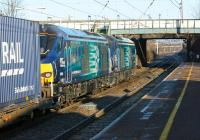 DRS 68007 and 68004 double head the 4S43 Daventry to Mossend Tesco container train through Leyland station on the morning of 6 February 2015.<br><br>[John McIntyre&nbsp;06/02/2015]