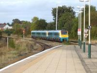 An Arriva Trains Wales 175/1 leads a 175/0 north out of Wrexham General late in the afternoon on 1 October 2012. The Wrexham - Bidston line through platform 4 is on the far left [see image 11054].  <br><br>[David Pesterfield&nbsp;01/10/2012]