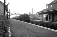 An up fast service running north through Glengarnock station in fading light on a July evening in 1963.<br><br>[Colin Miller&nbsp;/07/1963]