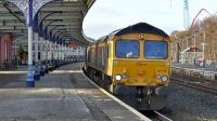 GBRf 66745 powers through Kilmarnock station on 5 February 2015 with loaded coal hoppers from Hunterston to Drax power station. This is a new path for GBRf.<br><br>[Ken Browne&nbsp;05/02/2015]