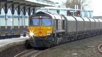 GBRf 66748 (purchased from Dutch Railways) photographed passing through Kilmarnock with loaded coal hoppers from Hunterston to Drax power station on 4 February 2015.<br><br>[Ken Browne&nbsp;04/02/2015]
