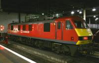 Recently repainted DB Schenker locomotive 90018 at the dimly lit south end of Euston's platform 16 on the evening of 10th February 2015. The locomotive would later take out the Highland <I>Caledonian Sleeper</I>, now in its last months of operation by First Scotrail before being taken over by Serco.<br><br>[Colin McDonald&nbsp;10/02/2015]
