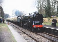 92220 <I>Evening Star</I>, bringing a train into Crowcombe Heathfield Station on the West Somerset Railway, during a shower of rain on 19 March 1989.<br><br>[Peter Todd&nbsp;19/03/1989]