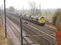 Freightliner 66588 on the northbound slow line at Overton Lane overbridge near Beningbrough on 12 February with a rake of empty coal wagons.<br><br>[David Pesterfield&nbsp;12/02/2015]