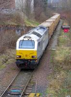 Grey liveried 67015 nearing its destination at Powderhall depot on 12 February 2015 with the returning empty 'bins' from Oxwellmains.<br><br>[Bill Roberton&nbsp;12/02/2015]