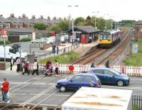 Northern Pacer unit 142067, forming the 1142 Saltburn - Darlington service, pulls up alongside platform 1 at Redcar Central station on 5 June 2013, just as the level crossing gates reopen on West Dyke Road.<br><br>[John Furnevel&nbsp;05/06/2013]