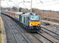 A <I>Six Nations</I> special from Carmarthen to Edinburgh, in connection with the Scotland-Wales match two days later, runs north through Hest Bank behind DRS 68005 <I>Defiant</I> on Friday 13th February 2015. The train was scheduled to return south again the following Monday.<br><br>[Mark Bartlett&nbsp;13/02/2015]