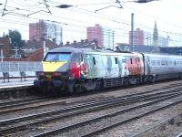 East Coast 91111 <I>'For the Fallen'</I> propels the 05.48 ex Waverley to Kings Cross service out of Doncaster on 11 February 2015.<br><br>[David Pesterfield&nbsp;11/02/2015]