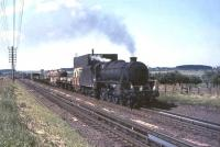 Carlisle Kingmoor Black 5 no 45009 passing over Stawfrank water troughs, south of Carstairs, on 17 July 1965 with an up freight.  <br><br>[John Robin&nbsp;17/07/1965]