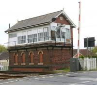 The stately-looking signal box at Strensall on the York - Scarborough line on 19 April 2009. View is south over Lords Moor Lane level crossing. <br><br>[John Furnevel&nbsp;19/04/2009]