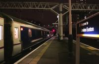 The Lowland Caledonian Sleeper headed by the 90029 in fresh DB Schenker red livery waits for the off at Euston platform 15 on 10 February.<br><br>[Colin McDonald&nbsp;10/02/2015]