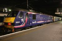 Locomotive 90021, still in EWS ScotRail livery, stands at Euston platform 15 on 10th February 2015 just after bringing in the empty stock of the Lowland Caledonian Sleeper.<br><br>[Colin McDonald&nbsp;10/02/2015]