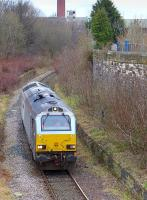 Grey liveried 67015 running light through the former Leith Walk Station on 12 February having delivered the empty <I>Binliner</I> containers to Powderhall depot. <br><br>[Bill Roberton&nbsp;12/02/2015]