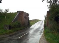 Views like this used to be quite common around the UK, but the march of progress - and deterioration of brickwork - has led to many demolitions. Looking south at Quinton on a soaking wet October day in 2010 [see image 45800]<br><br>[Ken Strachan&nbsp;01/10/2010]
