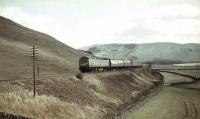 Brush Type 4 D1853 with a WCML train north of Crawford on 25 March 1966.<br><br>[John Robin&nbsp;25/03/1966]
