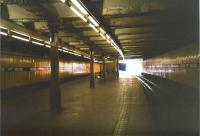 Anderston was a more atmospheric (or do I mean gloomy?) place before the white suspended ceiling was installed above the island platform. Here it is in July 1998, looking westwards. [See image 27786]<br> <br><br>[David Panton&nbsp;17/07/1998]