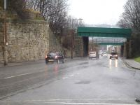 View east down Old Mill Lane, Barnsley, on a wet February day in 2015, showing the close proximity of the three bridges that once served the two main Barnsley stations. The abutment on the left once carried the MR line into Court House Station (closed in 1960). The two bridges beyond still carry lines to Barnsley (formerly Exchange) station, the nearest the MS&LR line to Penistone and the other the L&YR line to Wakefield Kirkgate.<br><br>[David Pesterfield&nbsp;16/02/2015]