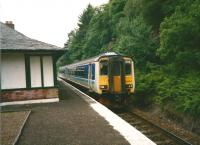 In June 1998 the morning Oban service waits to to pass the southbound train at Arrochar. Although into the privatisation era the Regional Railways livery was still to be seen for a while yet, though the double arrows were removed. <br><br>[David Panton&nbsp;/06/1968]
