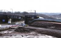 The Cutty Sark (Braehead) construction site viewed from Bredisholm Road on 25th February 2015 [see image 46153]. The new viaduct over the M8 extension will be constructed alongside the railway line and slid into place during a 2-week line closure in July 2015.<br><br>[Colin McDonald&nbsp;25/02/2015]