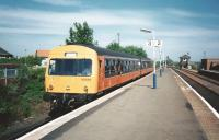 DMU 101689 slips into the bay platform at Barrhead on 4 June 1998 with a stopping Service from Glasgow Central. It nust have been a warm day as every window appears to be fully open (those were the days). Another bygone is people opening the door before the train came to a stop, as is happening here.<br> <br><br>[David Panton&nbsp;04/06/1998]