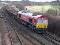 DBS 66097 passes Inverkeithing East Junction on 1 March with an empty Alloa - Millerhill ballast train.<br><br>[Bill Roberton&nbsp;01/03/2015]