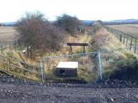 View east over the stub of the former Roslin branch looking towards the south end of Millerhill yard on 1 March 2015. The line closed following the last train from Bilston Glen Colliery in 1991 and the trackbed has now been severed by the new Borders Railway which runs north-south directly behind the camera. The recent addition in the foreground looks like an old chest freezer (?)... or possibly redundant point heating apparatus?<br><br>[Ewan Crawford&nbsp;01/03/2015]
