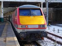 VTEC 91124 brings up the rear of the 12.00 service to Kings Cross at a wintry Edinburgh Waverley on 3 March.<br><br>[Bill Roberton&nbsp;03/03/2015]