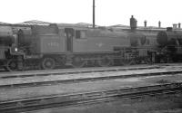 Stanier 3P 2-6-2T 40173 stands amongst other stored locomotives on Bangor shed in April 1963. 40173 had been officially withdrawn from here 9 months earlier.<br><br>[K A Gray&nbsp;01/04/1963]