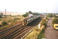 A Glasgow Queen Street - Edinburgh Waverley service passes Cadder signal box on 16 September 1998.<br><br>[David Panton&nbsp;16/09/1998]