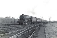 Dalry Road Black 5 44994 pulling away from the Kilwinning stop on 4 July 1959 on its way home with an Ayr - Edinburgh Princes Street train.  <br><br>[G H Robin collection by courtesy of the Mitchell Library, Glasgow&nbsp;04/07/1959]