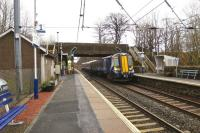 The 1430 Glasgow Central to Ayr train hammers through [and I mean hammers through] Lochwinnoch station on 5 March 2015.<br><br>[Colin Miller&nbsp;05/03/2015]