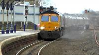 The 6H97 Hunterston - Drax coal runs through Kilmarnock station on 5 March 2015 hauled by GBRf 66745.<br><br>[Ken Browne&nbsp;05/03/2015]