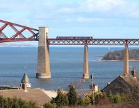 Passengers on the 1323 Cowdenbeath - Edinburgh Waverley service approaching South Queensferry on 4 March breath a collective sigh of relief, having safely completed their crossing of the Forth Bridge, after being <I>'buzzed'</I> by a Spitfire [see image 50544].  <br><br>[John Furnevel&nbsp;04/03/2015]