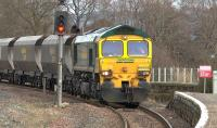 Freightliner 66529 with the 4S11 Drax - Hunterston empties about to pass through Kilmarnock station on 5 March.<br><br>[Ken Browne&nbsp;05/03/2015]