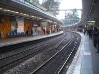 A view north along the curving platforms of Cite Universitaire station, located on the south side of Paris on RER Line B that runs between Aeroport Charles de Gaulle 2 and Saint Remy de Chevreuse.<br><br>[David Pesterfield&nbsp;25/02/2015]