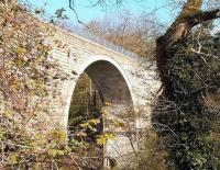 The sweeping single arch of the Edinburgh and Dalkeith Railway Company's Glenesk Viaduct (1830), seen from the east side illuminated by March sunshine in 2007. Photograph taken from the steep sided valley of the North Esk, on the edge of Dalkeith's Ironmills Park. [See image 14929]<br><br>[John Furnevel&nbsp;12/03/2007]