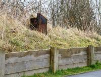 Remains of the former bracket signal that stood to the north of  Lochwinnoch station. [See image 44433] The surviving base now stands alongside the approach ramp to the cycle track.<br><br>[Colin Miller&nbsp;05/03/2015]