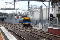 A Metro emu runs into the new sidings at Sunbury Victoria provided on electrification. View to the north [see image 41757 as it used to be].<br><br>[Colin Miller&nbsp;30/09/2014]