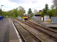 A train for Maidenhead comes off the Marlow branch on a Spring Saturday morning in 2014. Notice the signalling shed for the token on the right.<br><br>[Ken Strachan&nbsp;26/04/2014]