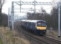 320321 on a Whifflet - Milngavie service passing the site of Tannochside Junction on 12 March 2015. The orange hi-viz jackets of construction workers building the M8 Braehead railway viaduct can just be seen in the left background.<br><br>[Colin McDonald&nbsp;12/03/2015]