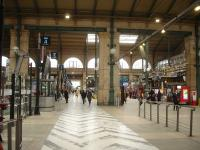 Looking west to east along the lengthy concourse at Gare du Nord in February 2015. Platforms are numbered 2 to 19, with platforms 2 to 5 for Eurostar services only. The concourse for the easternmost platforms is beyond the main building and is enclosed in a modern glass structure [See image 50643]. <br><br>[David Pesterfield&nbsp;26/02/2015]