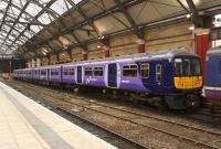 New kid in town. 319363, sporting its recently acquired <I>'Northern Electrics'</I> livery, stabled in Liverpool Lime Street platform 1 on the afternoon of 12 March 2015.<br><br>[John McIntyre&nbsp;12/03/2015]