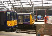 View from the concourse at Liverpool Lime Street on 12 March 2015 showing 5 different unit types at the buffer stops. From left to right are classes 319, 142, 150, 185 and 156.<br><br>[John McIntyre&nbsp;12/03/2015]