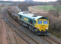 Freightliner 66550 passes Inverkeithing East Junction with spent ballast  for Millerhill on 15 March.<br><br>[Bill Roberton&nbsp;15/03/2015]
